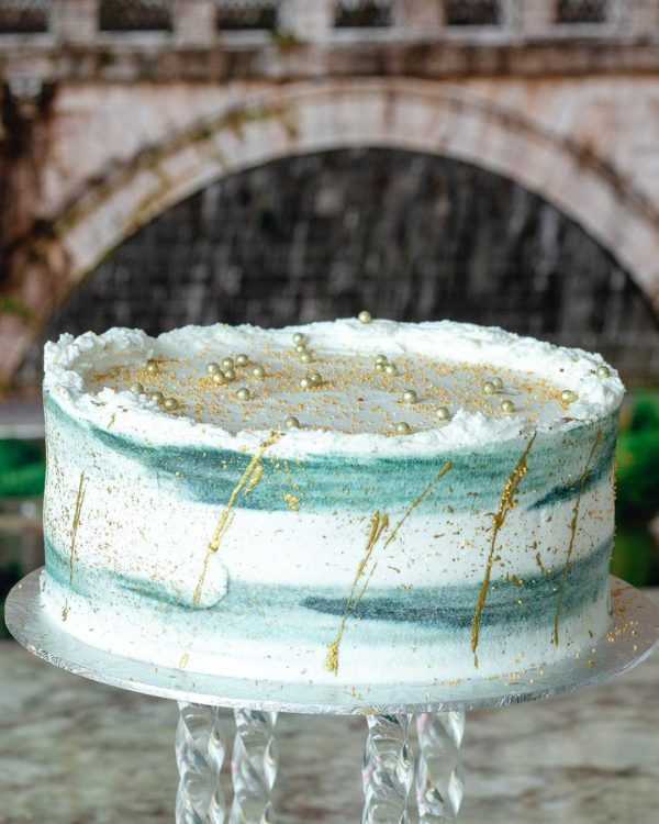 gold decorated buttercream cake